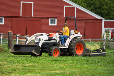 Bobcat_CT450_with_bucket_and_rotary_cutter